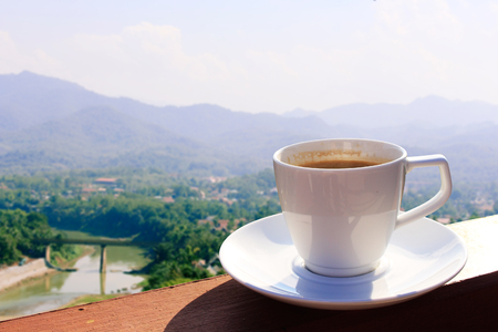 lao: Morning cup of coffee with mountain background