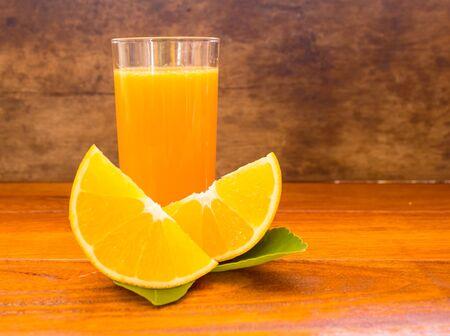 backgruond: orange ,orange juice, orange and orange juice on wood backgruond.