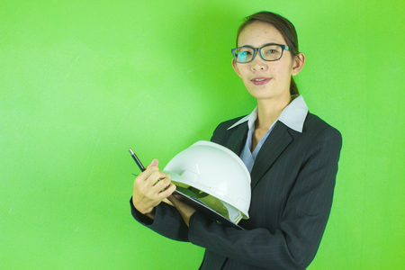 business woman Holding a pen, hat engineer and paper board. Stock Photo
