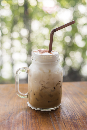 Ice coffee with milk on the wooden table Stock Photo