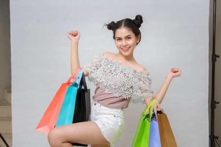 shopper: Attractive shopper woman holding shopping bags
