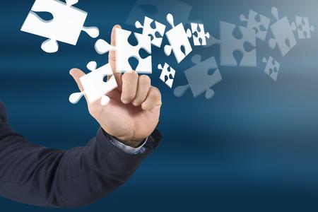 businessman touching 3D puzzle , business concept