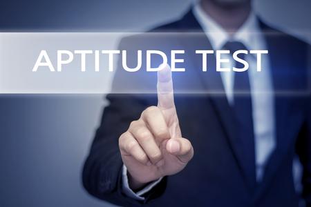 Businessman hand touching APTITUDE TEST button on virtual screen