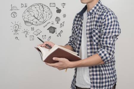 higher intelligence: close up  of university student male  with education icon