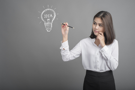 charisma: Beautiful business woman with idea icon Stock Photo
