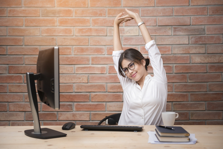 Beautiful woman is relaxing in modern home office Stock Photo