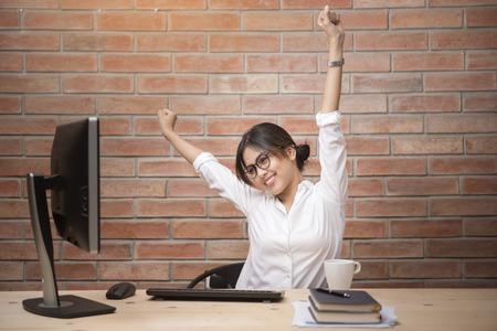Beautiful woman is relaxing in modern home office Standard-Bild