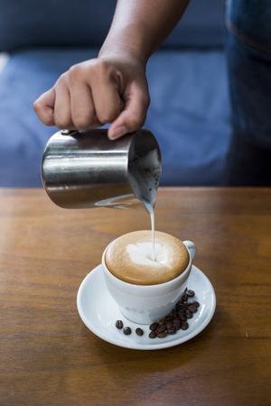 Making of latte art coffee Stock Photo