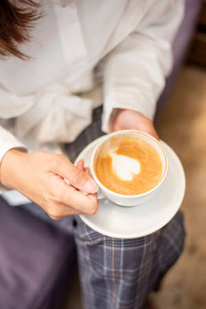 close up of beautiful woman is drinking coffee