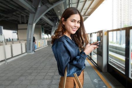 Beautiful business woman in metro train in city