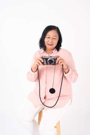 Asian older woman on white background, Travel concept