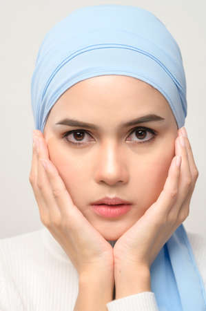 A close up of young beautiful muslim woman with hijab isolated on white background studio, muslim beauty skin care concept.