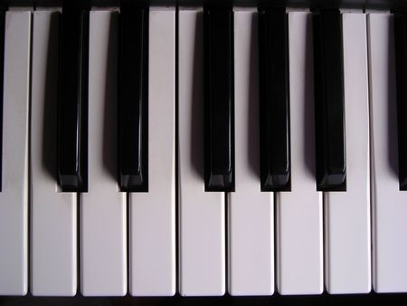 Top view of an octave of an electronic organ keyboard. Stock Photo