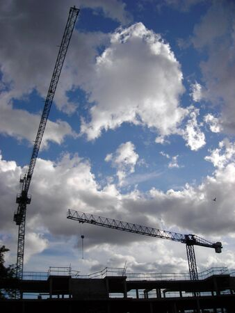 Two cranes working on the construction of a building in Madrid.