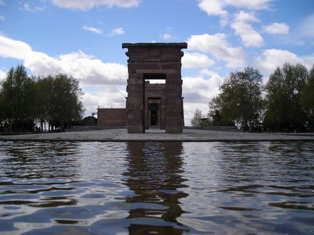 View of the Debod Temple in Madrid surrounded by a pond and trees, a gift from egiptian king to Juan Carlos I, King of Spain.