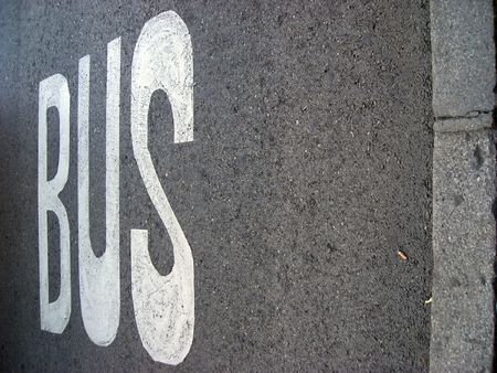 The bus line sign over asfalt of a city street. Copy space avaialble.