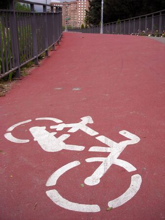 Cyclist line sign over a pedestrian bridge over M-30 highway in Madrid.