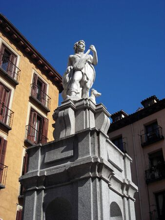 Statue of a violin player in a small square close to Plaza Mayor in the very center of Madrid Stock Photo