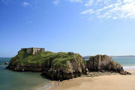 Summer low tide view of the Saint Catherine Island and South Beach at Tenby, Wales.