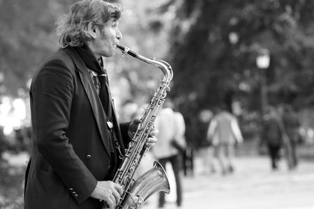 Portrait of a sax player in front of the Prado Museum in Madrid.