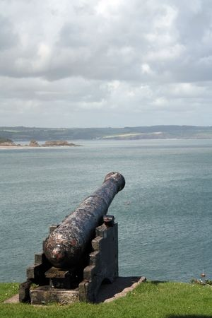 tenby wales: An old cannon aiming to the Irish Sea on the hill of Tenby, Wales, UK.
