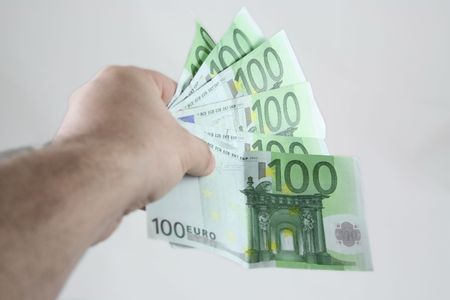 Worker hand holding 600 euros. Stock Photo