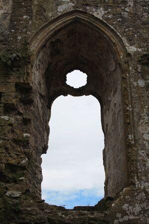 pembrokeshire: An ancient window of the Pembroke Castle in Pembrokeshire, Wales.