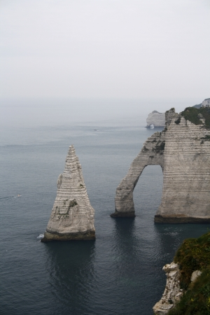 The famous cliffs in Etretat, Aval, Amont and the isle of LAiguille.