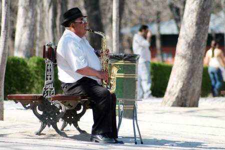 Portrait of a gipsy sax player in Madrid. Stock Photo - 15454553