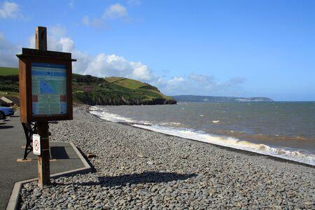 View of the coast line at Aberaeron peebles beach, Wales, UK. Stock Photo