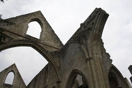Jumieges, France, April 16 2011: Detail of the ruin of the Saint-Pierre Church inside the ancient Abbey of Jumieges, founded at 7th century, Seine-Maritime, Upper Normandy, France. Editorial