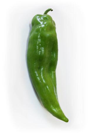 Fresh green pepper on a white