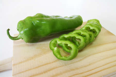Some slices of Green Pepper on a table