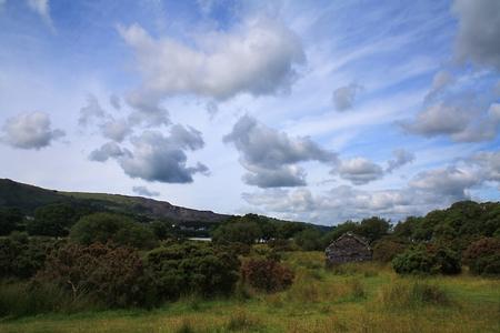 A stone shack in a meadow at Llanberis, small town inside Snowdonia National Park, Gwynedd County, Wales