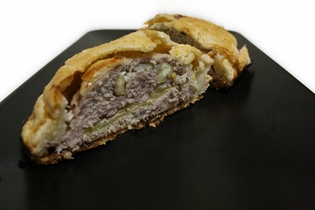 Pork Pie with chesnuts and apple, ready to eat. Stock Photo