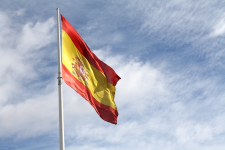 enormous: The enormous Spanish flag at Columbus Square in Madrid, waving on a windy day.