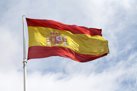 The enormous Spanish flag at Columbus Square in Madrid, waving on a windy day.