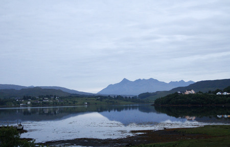 Loch Portree with the Cuillin Mountains in the distance, Skye Island, Scotland  Stock Photo