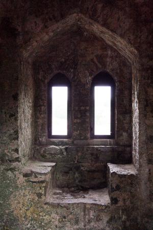 Stone window of Pembroke Castle from inside  Wales, UK  Stock Photo