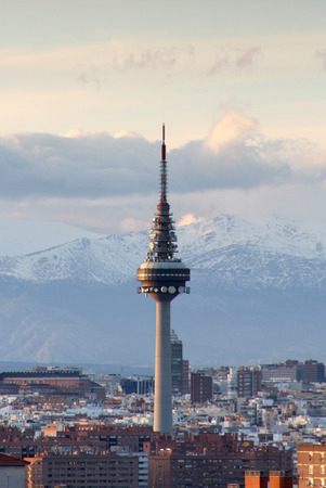 Telecommunication tower in Madrid with the snowy mountains in the distance  Editorial