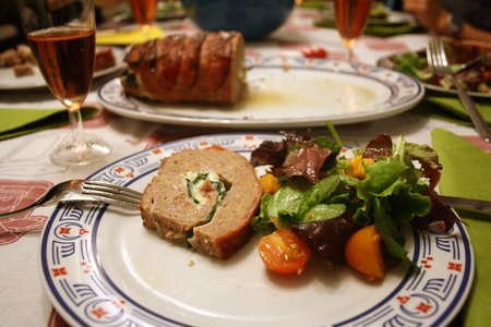 Table ready for dinner, meat cake with salad. Stock Photo