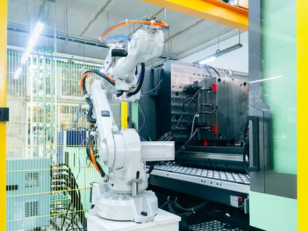 Smart factory industry 4.0 concept from robotic arm machine tool for production line of injection molding process at vehicle industrial factory.