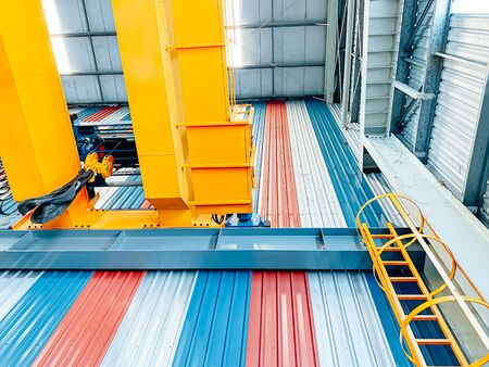 Overhead crane and fixed ladder inside factory building, industrial background Imagens