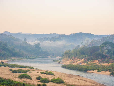 Beautiful landscape with morning atmosphere of mountain and river at Moei River, Tak, Thailand