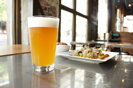weizen beer with bacon salad. Stock Photo