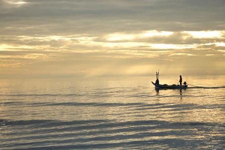 hua hin: fisher man and boat in the sea Hua Hin Thailand