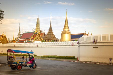 the emerald city: Tuk Tuk taxi waiting customers about Wat Phra Kaeo Bangkok