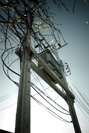 isolator insulator: Transformers of an electrical post with powerlines
