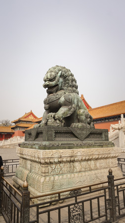 heritage protection: A bronze lion statue in Forbidden City
