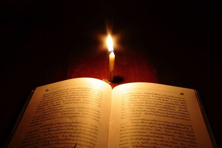 Reading under candlelight